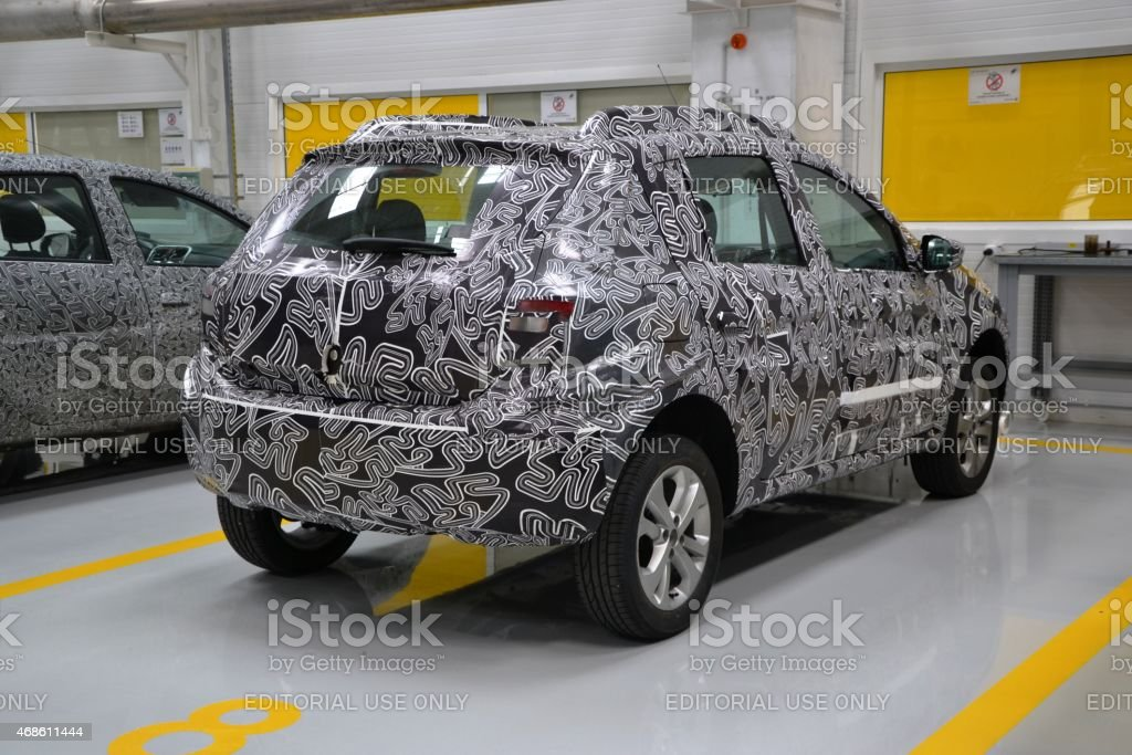 Camouflage car on the tests stock photo