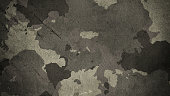 istock Camouflage cloth texture. Abstract background and texture for design. 1287561722