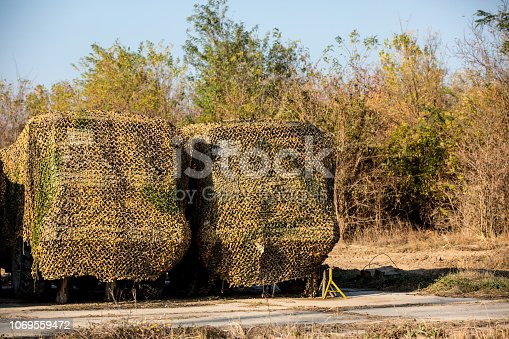 camouflage grid hiding a military vehicle