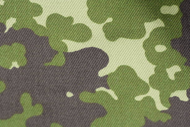 Camouflage - military uniform cloth in NATO pattern full frame stock photo