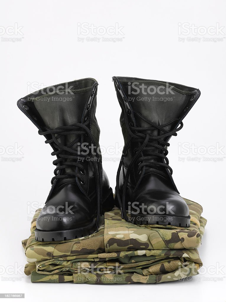 Camouflage uniform and a pair army boots. stock photo