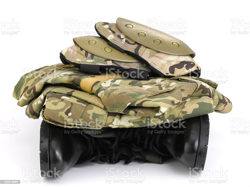 Camouflage uniform on top a pair army boots royalty-free stock photo