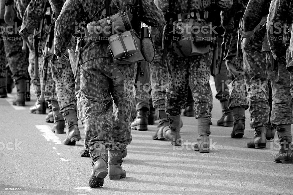 Camouflaged Marching Troops. royalty-free stock photo
