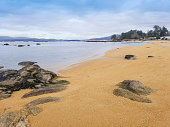 Granite rocks and shore of Campamento beach in Vilanova de Arousa, Galicia, Spain