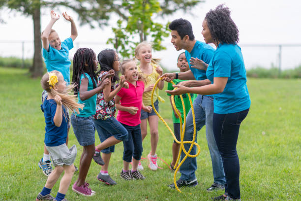Camp Counsellors and Children Getting Ready for Tug-of-War Game stock photo