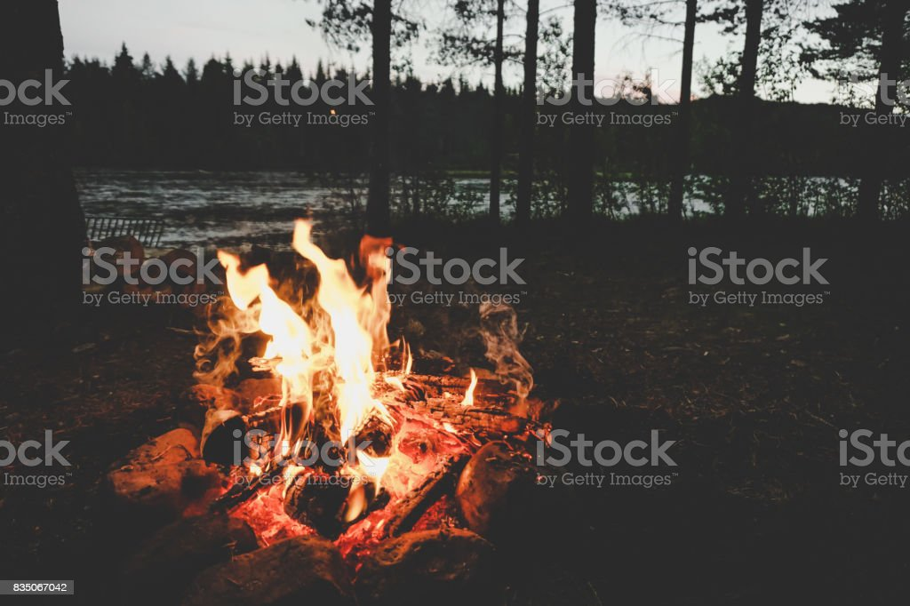 Camp fire on a Swedish river stock photo