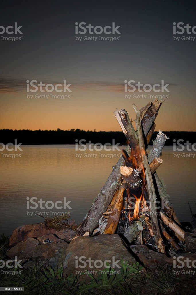 Camp fire on the lake stock photo