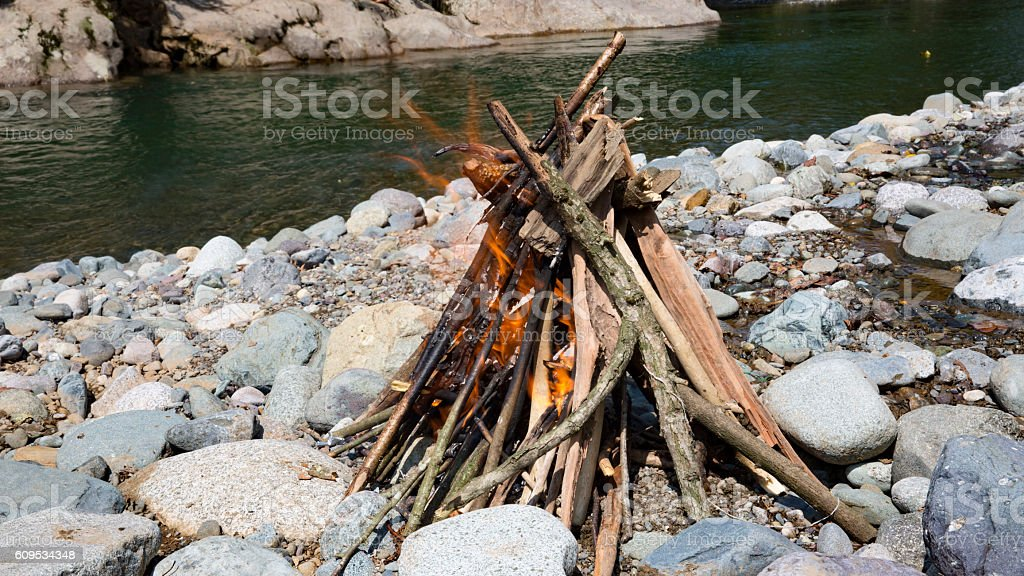 camp Fire side river stock photo