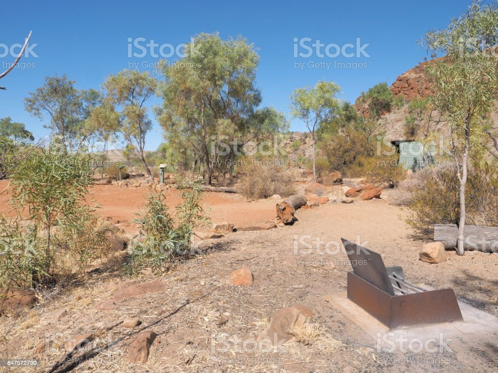 Camp ground with fire pit at remote N'Dhala Gorge near Ross River Station stock photo
