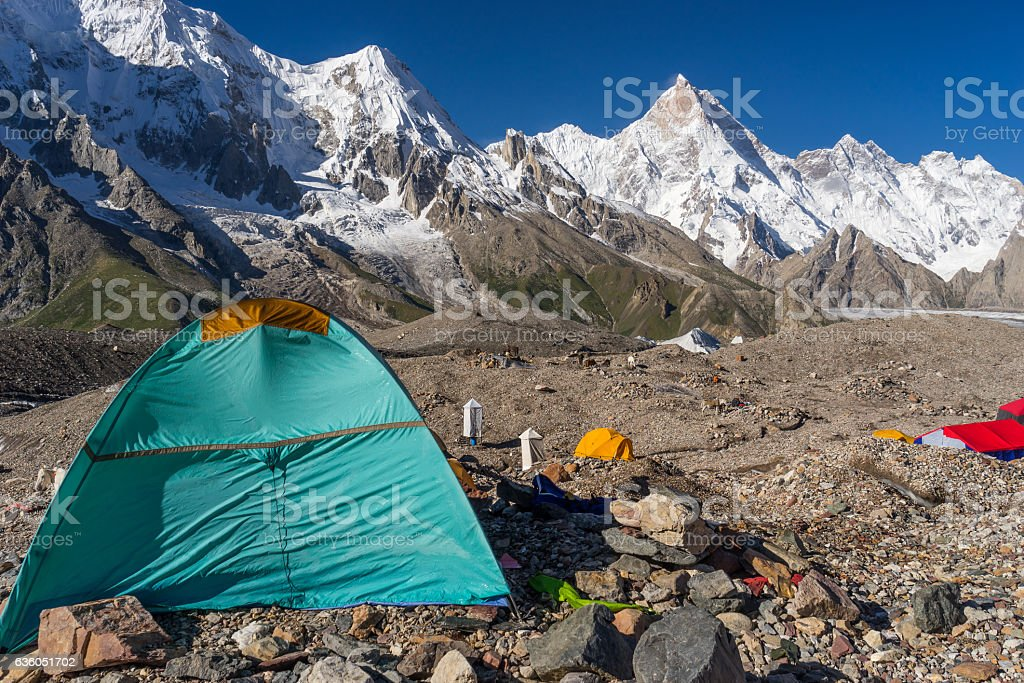 Camp site at Goro II with Masherbrum peak, K2 trek stock photo