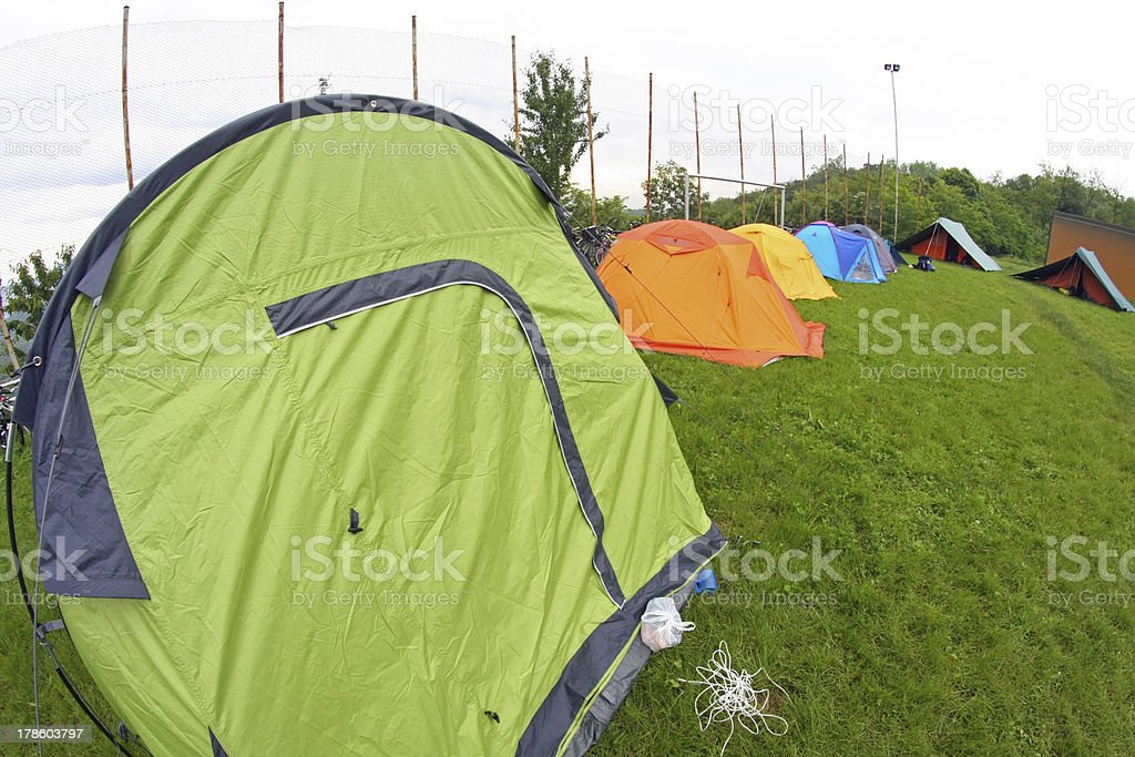 camp with tents scout campers in a green meadow royalty-free stock photo