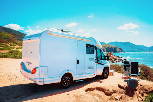 RV Camper Car at Mediterranean Sea Italy stock photo