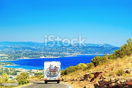 istock RV Camper Car with bicycles on Road in France 1008958392