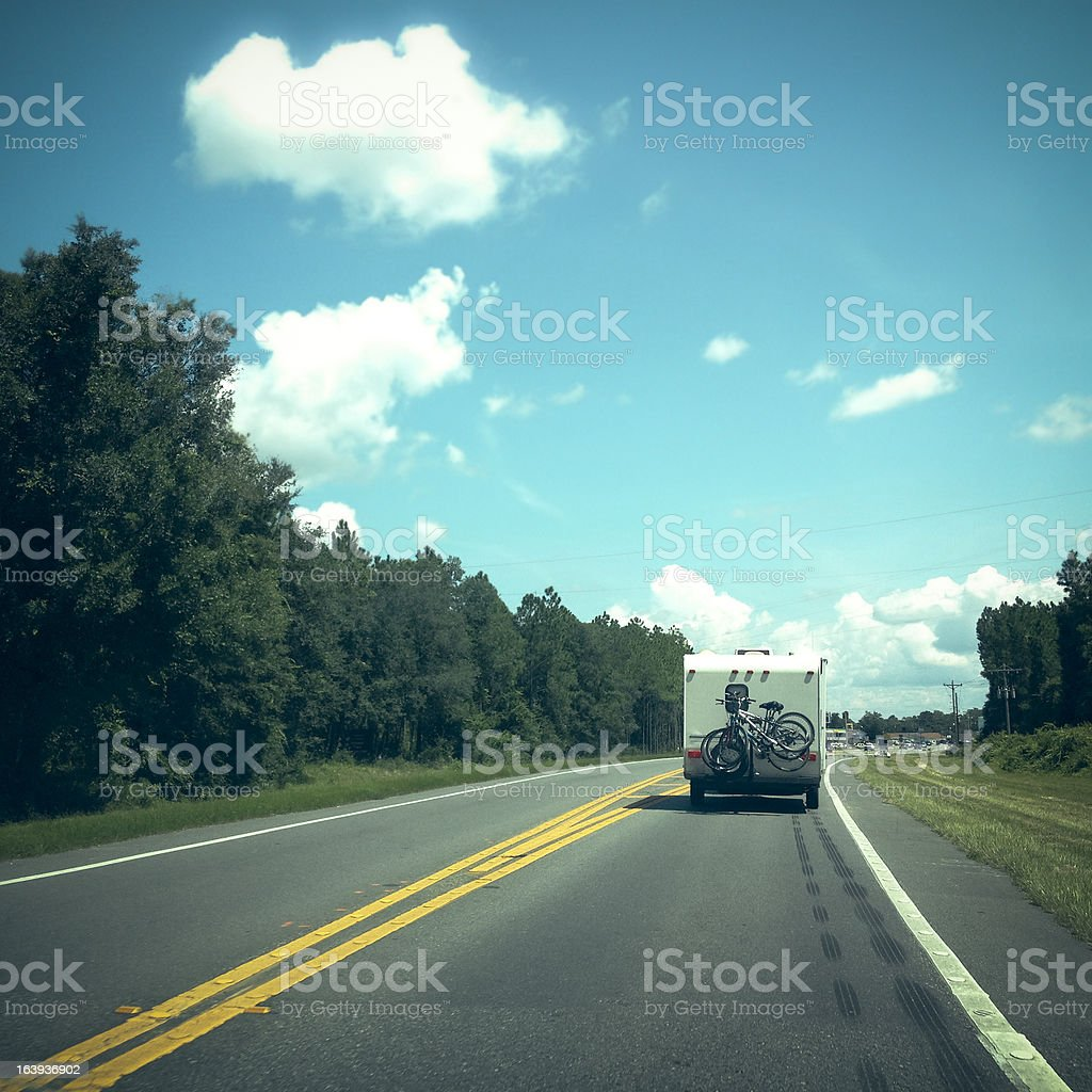 Camper Driving Down a Highway stock photo