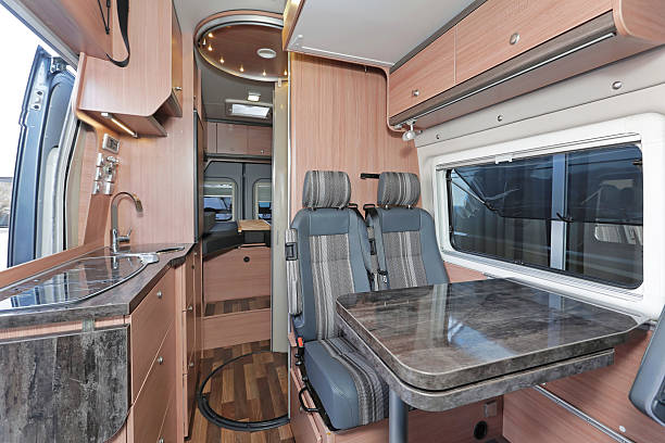 Camper interior Kitchen and dining table in camping van rv interior stock pictures, royalty-free photos & images