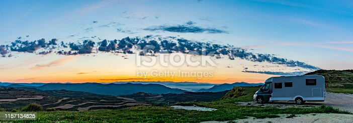 istock Camper on a hill at sunrise 1157134825