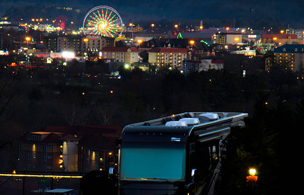 Camper overlooking Pigeon Forge at night Pigeon Forge, TN, USA -December 5, 2015: Camper overlooking the valley of Pigeon Forge at night. pigeon forge stock pictures, royalty-free photos & images