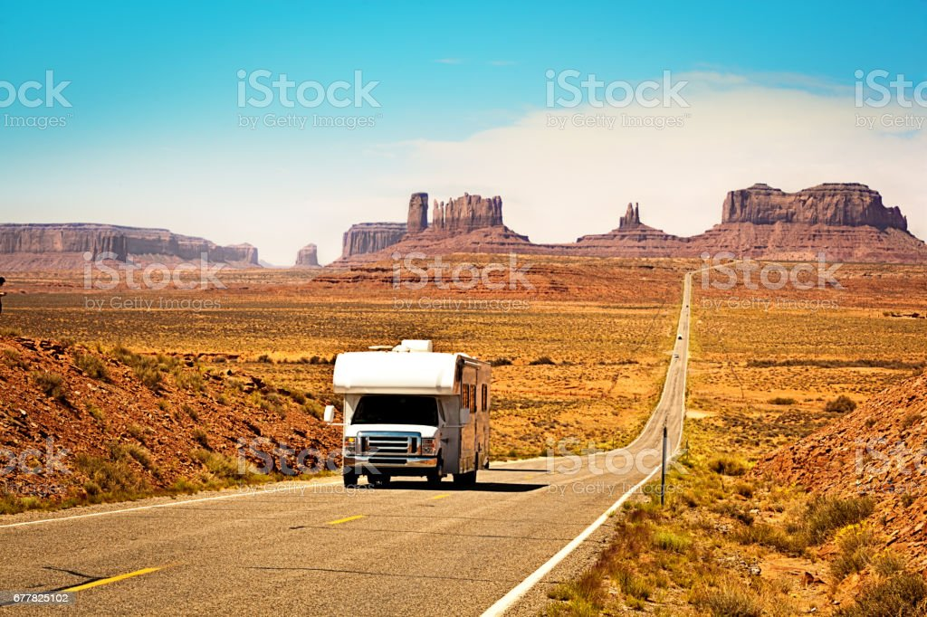 RV Camper Road Trip at Monument Valley Tribal Park Landscape stock photo