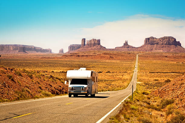 rv camper road trip at monument valley tribal park landscape - motorhome stock photos and pictures