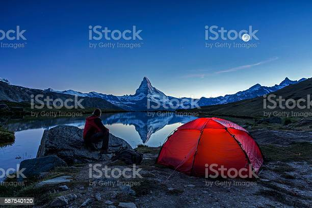 Photo of Camper under full Moon at Matterhorn