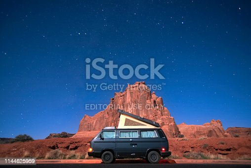 Arches National Park, Utah - November, 20, 2019: A Volkswagen van in a parking lot at night on November, 20, 2019 in Arches National Park, Utah.