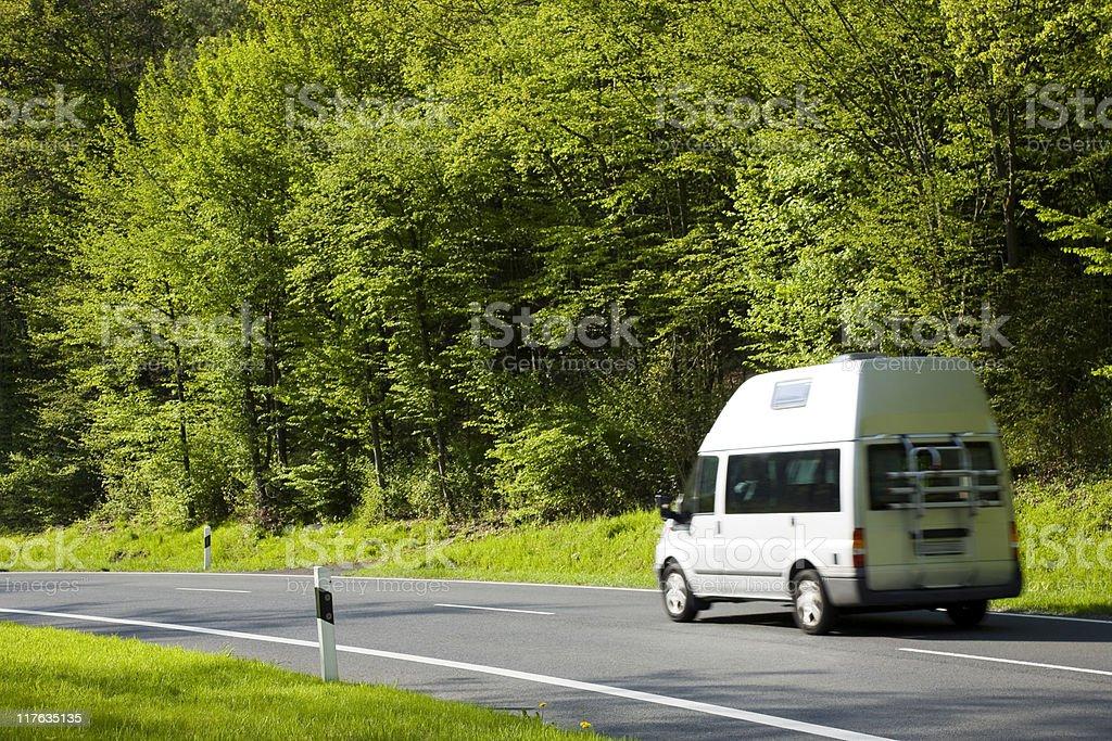 Camper Van, Motorhome, On Country Road in Spring royalty-free stock photo