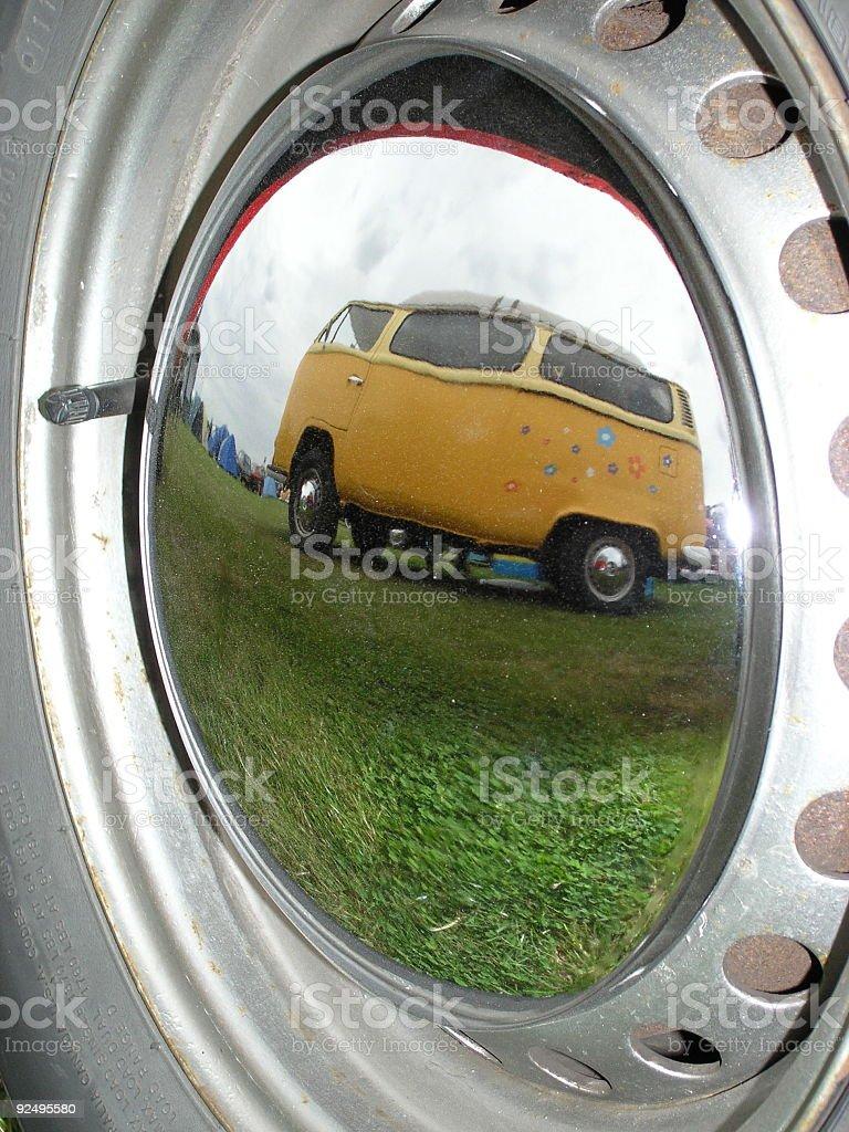 Camper van reflection in wheel rim royalty-free stock photo