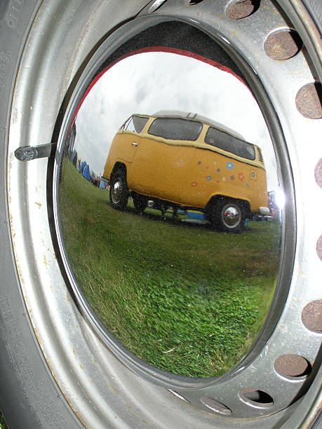 Camper van reflection in wheel rim Classic hippie mobile camper van reflected in the chrome rims of another. skeable stock pictures, royalty-free photos & images