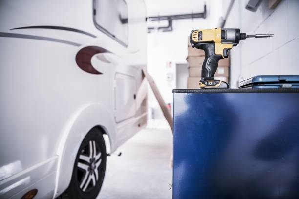 Camper Van RV Repair Camper Van RV Repair Concept. Recreational Vehicle in the Service Center. Drill Driver Power Tool. rv interior photos stock pictures, royalty-free photos & images