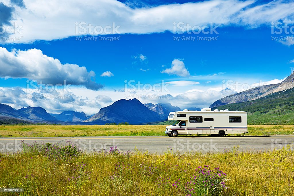 RV Camper vehicle at Glacier National Park, Montana stock photo