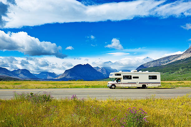 rv camper vehicle at glacier national park, montana - motorhome stock photos and pictures