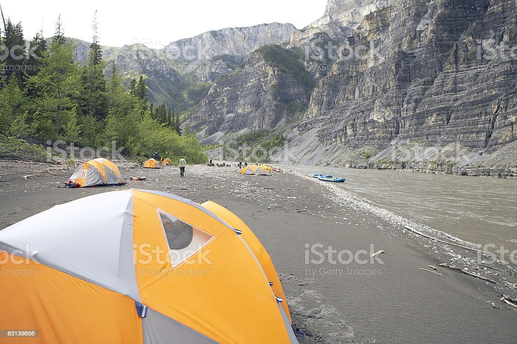 campers and campsite near river royalty-free stock photo