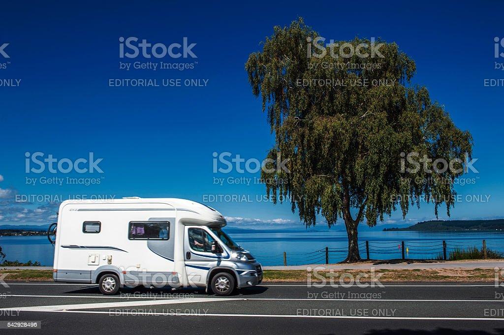 Campervan driving along Lake Taupo, New Zealand stock photo