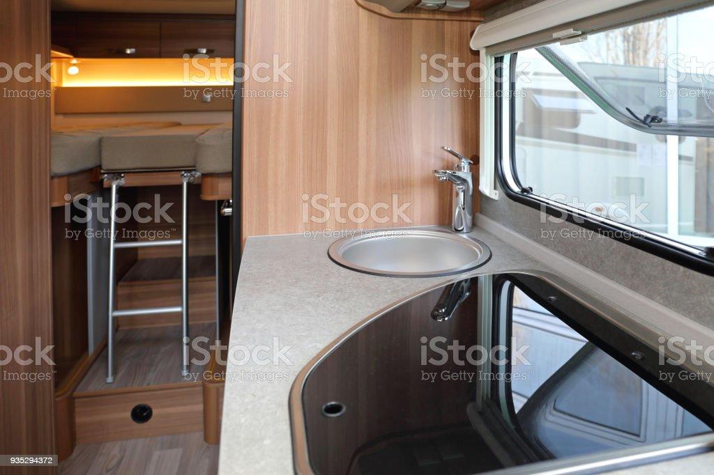 Campervan Interior Kitchen Counter and Bedroom in Camper Van Bed - Furniture Stock Photo