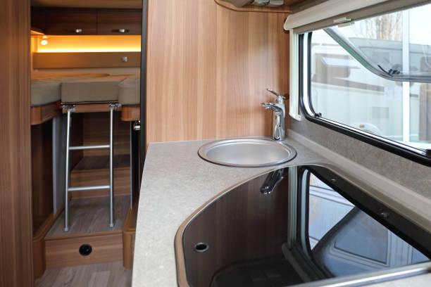 Campervan Interior Kitchen Counter and Bedroom in Camper Van rv interior stock pictures, royalty-free photos & images