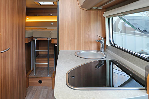 Campervan Kitchen Kitchen and bedroom in camping van rv interior stock pictures, royalty-free photos & images