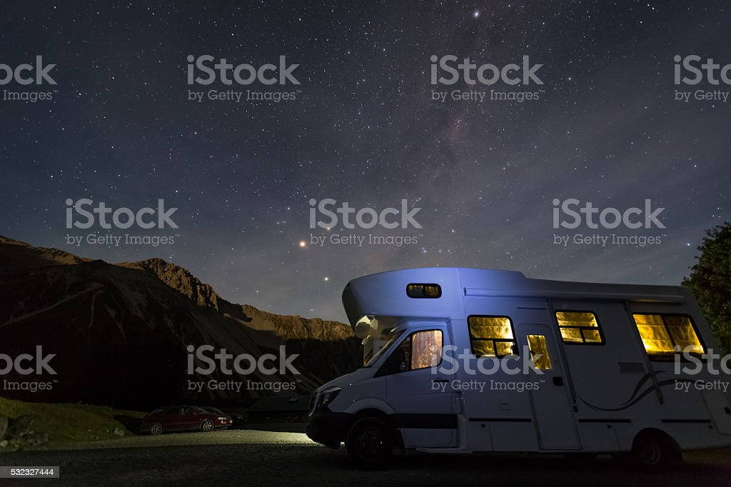 campervan with milky way at night stock photo
