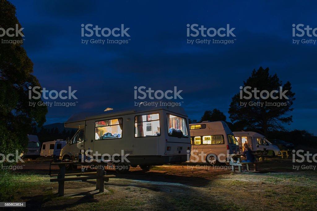 Campervans camping at Peketa Beach, Kaikoura, New Zealand stock photo