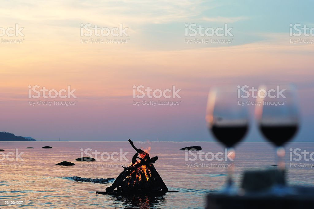 Campfire and wine glasses with wine stock photo