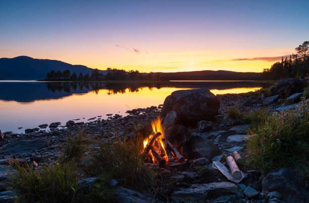 Campfire at a lake stock photo