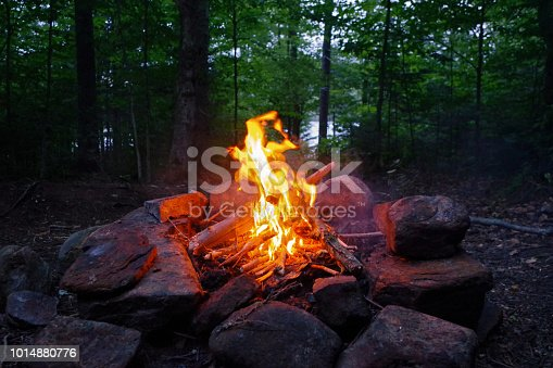 I built a fire after a rainstorm in the wilderness of Upstate New York. I shot the photo right after dark.