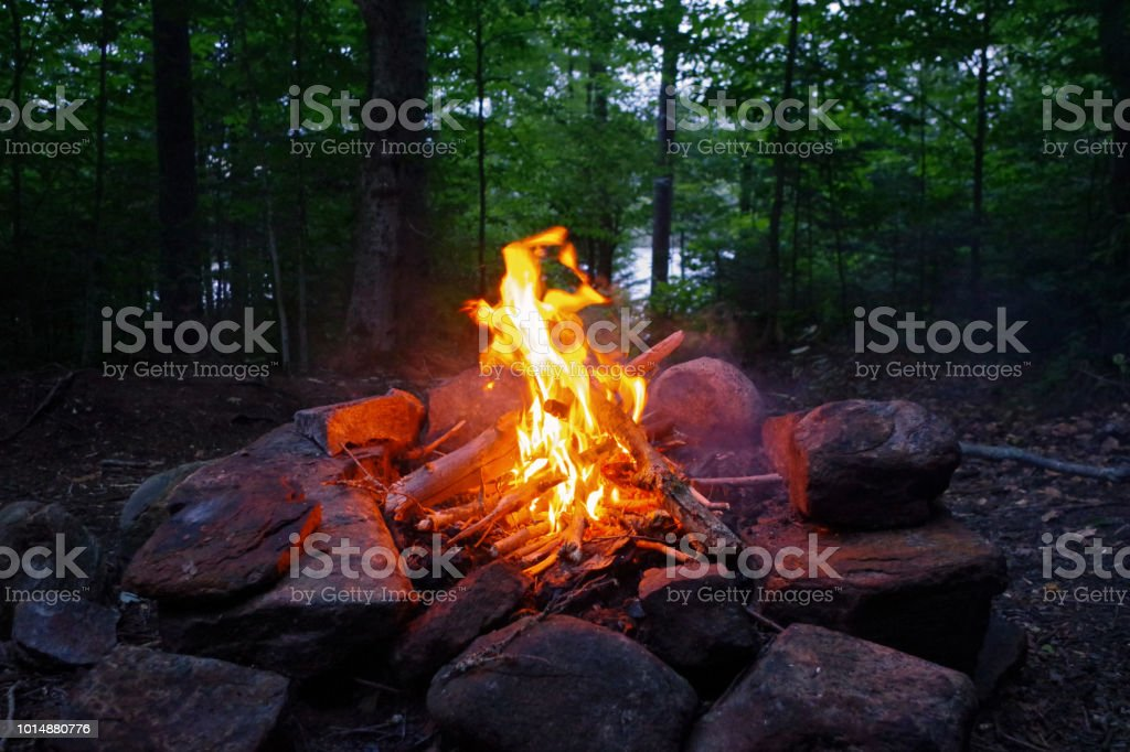 Campfire at camp in the Adirondack Mountains of Upstate New york. stock photo