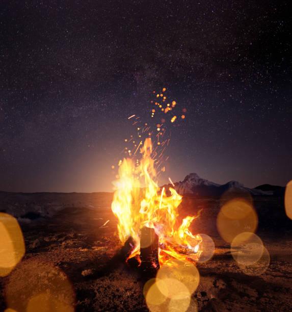 Campfire At Night Watching The Stars stock photo