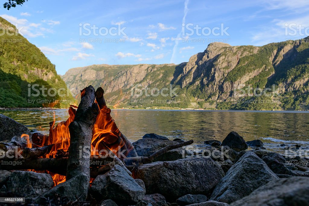 Campfire in a fjord in Norway during summer stock photo
