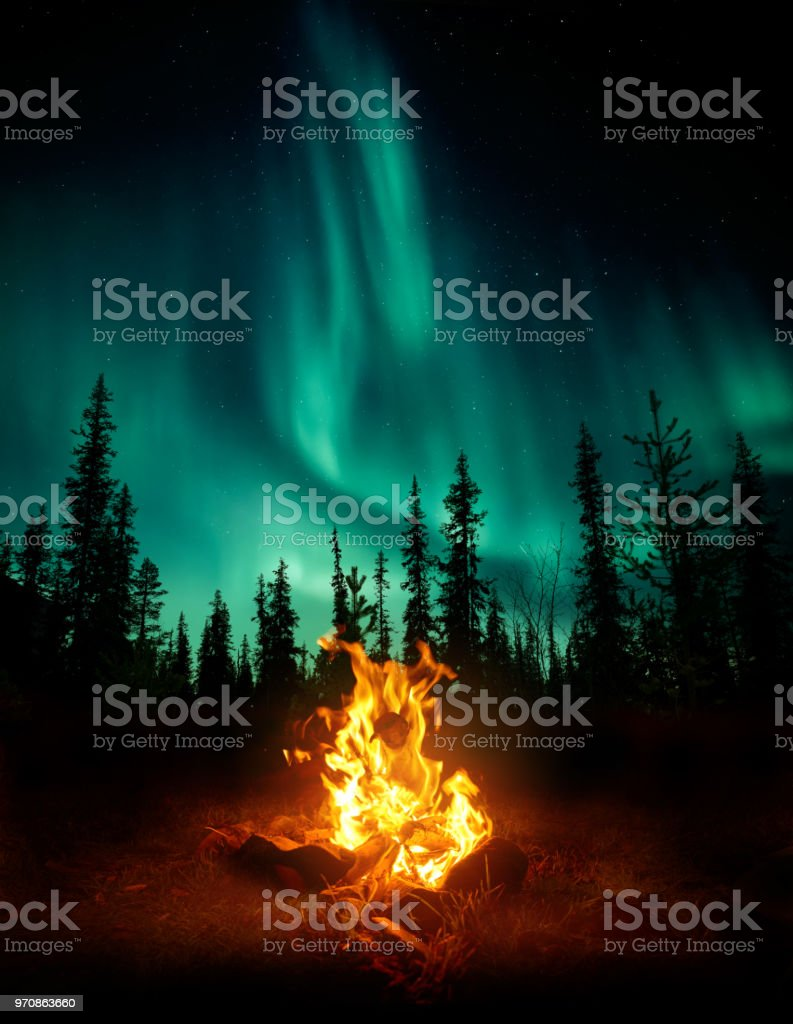 Campfire In The Wilderness With The Northern Lights stock photo