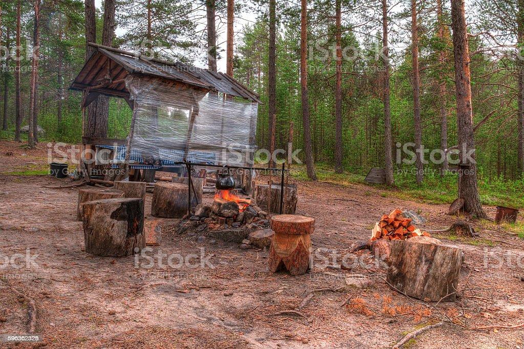 Campfire near gazebo in forest royalty-free stock photo