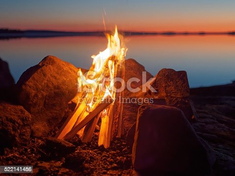 470521655 istock photo Campfire on the beach at night 522141486