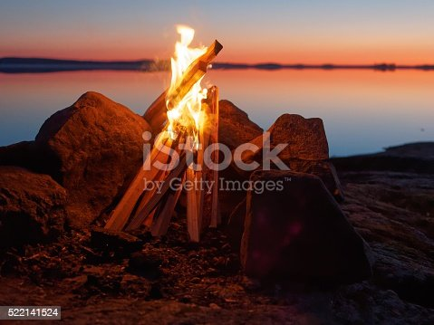 470521655 istock photo Campfire on the beach at night 522141524
