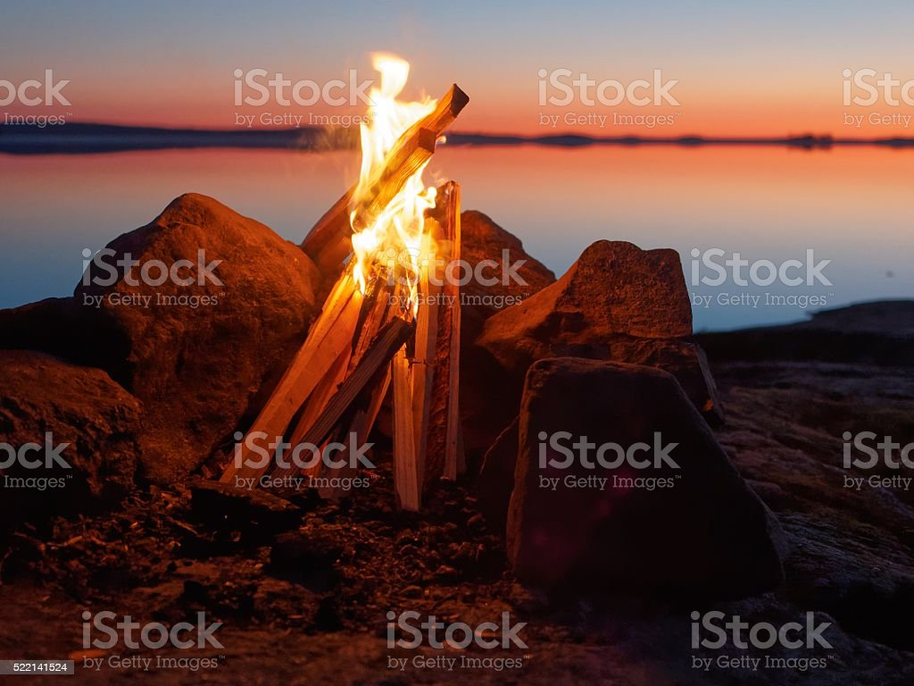 Campfire on the beach at night stock photo