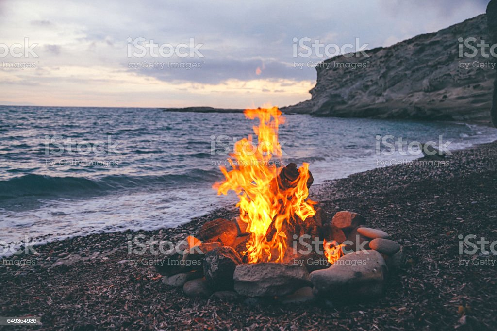 Campfire on the beach stock photo